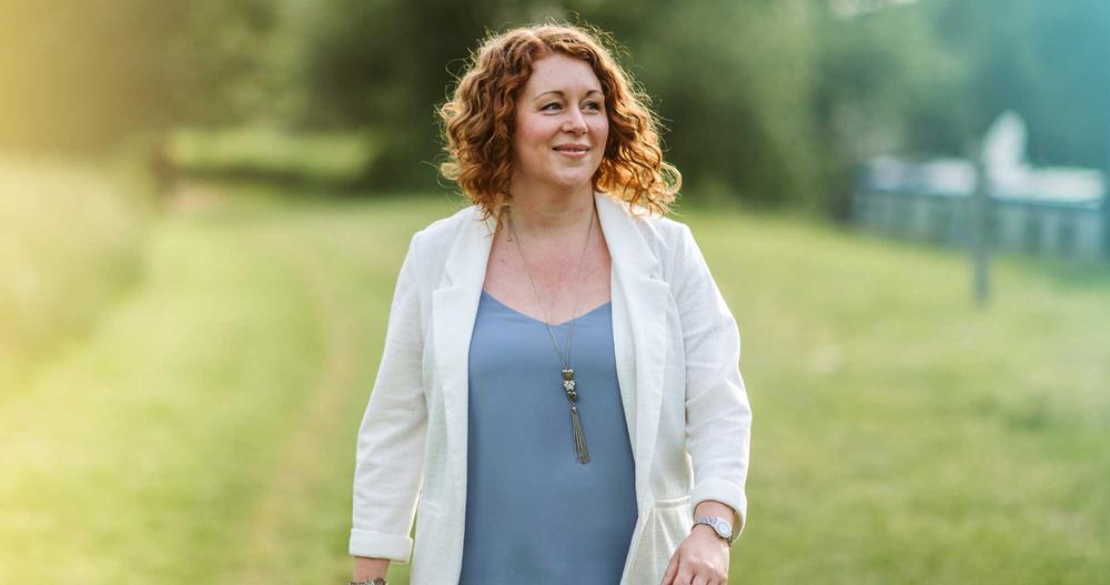 Hazel Richards walking through a field looking right